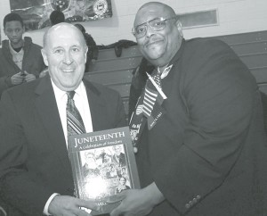 Dr. Ronald Myers, Sr. and Governor Jim Doyle share a moment following the offi cial signing of the Juneteenth day legislation. (photo by Harry Kemp)