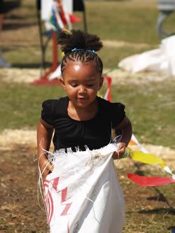 Little girl enjoys sack race at Wisconsin State Fair.