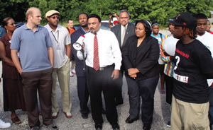 BP gas station co-owner Jay Walia addresses the crowd at Tuesday evening's rally and march against violence. Other speakers included (l to r), Sen. Lena Taylor, Ald. Willie Wade, Ald. Nik Kovac, Ald. Ashanti Hamilton, Supervisor Willie Johnson, Jr., Ald. Milele Coggs and rally organizer Michael Hagler. (Photo by Robert A. Bell)