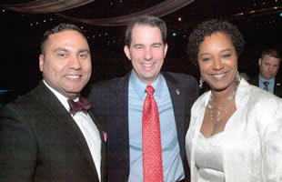 Attending The Hispanic Chamber of Commerce dinner last weekend, Eugene Manzanet, VP of PNC Bank, Governor Scott Walker and Senator Lena Taylor show their support for the Chamber. (Photo by Cy White)
