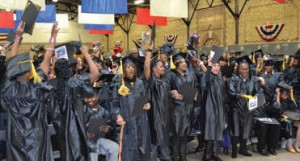 Graduates celebrate at the end of the SDC December 2013 graduation ceremony.