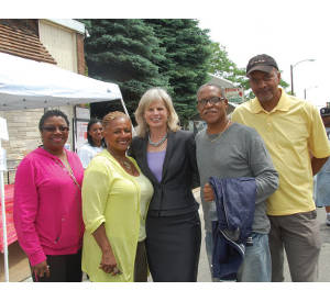 Mary Burke celebrating Juneteenth Day with parade goers