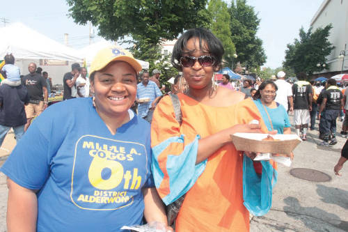 Alderwoman Milele Coggs and a attendee at Garfield Days