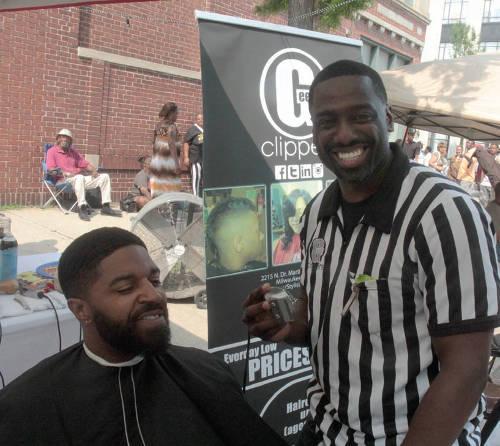 Festival attendee getting hair groomed