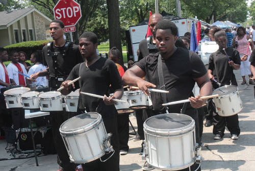 Young men playing the drums