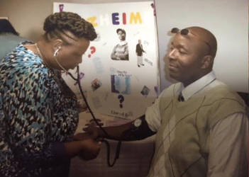 One speaker, Eucita Seals, takes the blood pressure of one seminar attendee. Photo by Venodia Reaves.