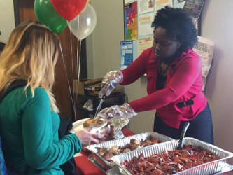 A students gets in line for a holiday meal from Concordia University's DYF campus. Photo by Ariele Vaccaro.