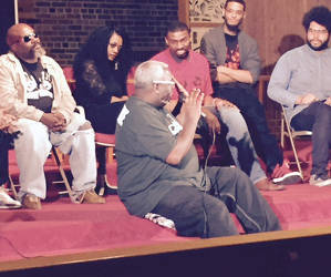 Maurice Beckley offering solutions to relationships between police and the community with cast of Hands Up. Photo by Karen Stokes.