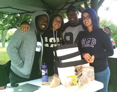 Emman Odofu, Sam Giarratani and Jasmine Velez and Will Sylvester take shelter from the rain at the Increase the Peace Hip Hop Festival . (Photo by Mrinal Gokhale)