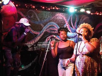 """Klassik, Kyndal J, and B Free handle vocals during the """"Coronation"""" release party. (Photo by Dylan Deprey)"""
