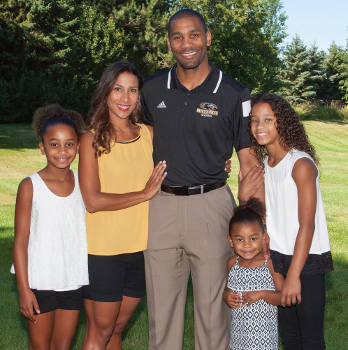 Destinee and LaVall Jordan and their daughters enjoy a sunny moment at their new home. The family moved to Wisconsin this summer, after Jordan was named the new head men's basketball coach at UW-Milwaukee. (UWM Photo/Troye Fox)