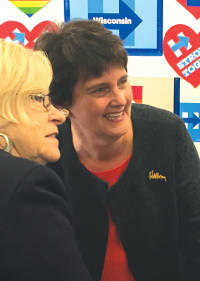 Anne Holton (right) meets voters at Milwaukee Early Voting event. (photo by Karen Stokes)